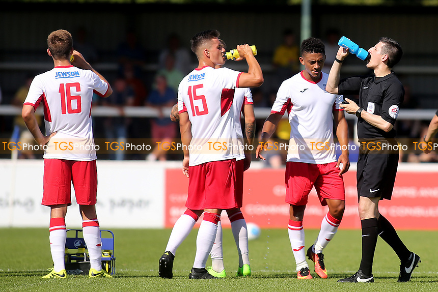 The Assistant Referee takes advantage of a refreshment break for the players as he helps himself to a drink during Woking vs Watford, Friendly Match Football at The Laithwaite Community Stadium on 8th July 2017