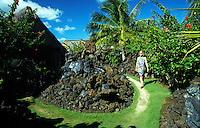 Woman walking on a path at the Mauna Lani spa on the Big Island of Hawaii