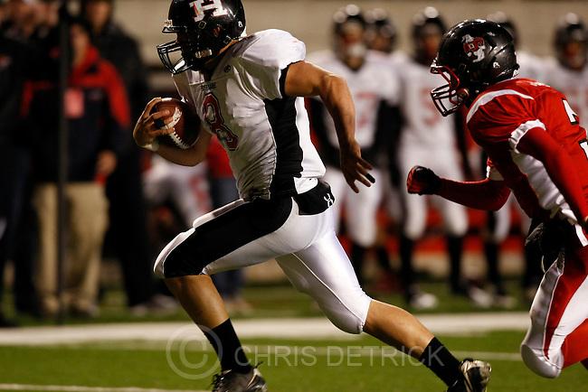 Chris Detrick  |  The Salt Lake Tribune .Hurricane's Brian Scott #8 runs past Delta's Jace Johnson #3 for a touchdown during the first half of the 3A Semi-final game at Rice-Eccles Stadium Thursday November 11, 2010.