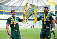 Anthony Allen and Manu Tuilagi lift the Aviva Premiership trophy in celebration. Aviva Premiership Final, between Leicester Tigers and Northampton Saints on May 25, 2013 at Twickenham Stadium in London, England. Photo by: Patrick Khachfe / Onside Images
