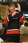 Tor Helness reacts to winning a hand.