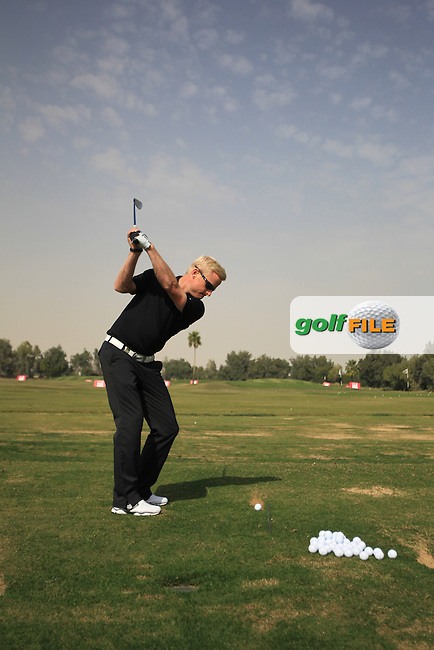 Simon Dyson (ENG) on the practice range during Monday's Practice Day of the Commercial Bank Qatar Masters 2013 at Doha Golf Club, Doha, Qatar 21st January 2013 .Photo Eoin Clarke/www.golffile.ie