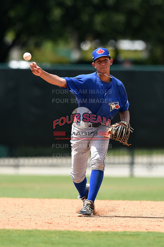 GCL Blue Jays shortstop Yeltsin Gudino (5) throws to first during a game against the GCL Braves on June 27, 2014 at the ESPN Wide World of Sports in Orlando, Florida.  GCL Braves defeated GCL Blue Jays 10-9.  (Mike Janes/Four Seam Images)