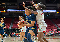 COLLEGE PARK, MD - NOVEMBER 20: Kaila Charles #5 of Maryland defends gainst Kayla Mokwuah #24 of George Washington during a game between George Washington University and University of Maryland at Xfinity Center on November 20, 2019 in College Park, Maryland.