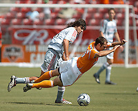 FC Dallas midfielder Juan Toja (8) trips up  Houston Dynamo midfielder Brian Mullan (9).  Houston Dynamo beat FC Dallas 2-1 at Robertson Stadium in Houston, TX on June 3, 2007.