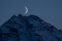 Moonrise over Pioneer Peak, Alaska. Photo by James R. Evans