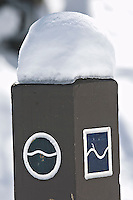 A hiking trail signpost displays the symbols for an easy trail and a more difficult trail.