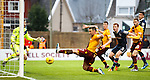 Scott McDonald cant quite stretch to poke the ball away this time