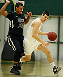 SPEARFISH, SD - FEBRUARY 4, 2017 -- Stefan Desnica  #33 of Black Hills State drives past Brandon Malone #23 of UCCS during their Rocky Mountain Athletic Conference game Saturday at the Donald E. Young Center in Spearfish, S.D.  (Photo by Dick Carlson/Inertia)