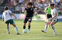 Stephanie Logterman (3) and Niki Cross (19) join forces to defend Eriko Arakawa (30). FC Gold Pride tied the St. Louis Athletica 1-1 at Buck Shaw Stadium in Santa Clara, California on August 9, 2009.