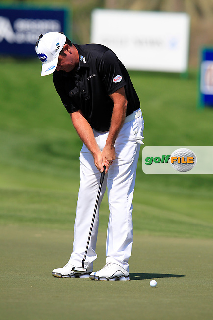 Scott Hend (AUS) putts on the 10th green during Thursday's Round 1 of the 2015 Omega Dubai Desert Classic held at the Emirates Golf Club, Dubai, UAE.: Picture Eoin Clarke, www.golffile.ie: 1/29/2015