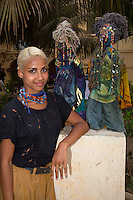 Sara Maurin Kane Standing Next to Mami Watas, Artistic Creations of Sylvette Maurin.  Goree Island, Dakar, Senegal.  In West African mythology, mami watas are Mythological Guardians of the Sea.