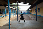 A student walks along a walkway at the John Paul II School in Wau, South Sudan.