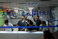 Unemployed and in new students look for work at a job fair and employment centre in Guangzhou, China. Competition for well paid jobs is fierce in Guangzhou that produces thousands of university gradutaes annually..27 May 2006