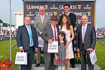 Best Dressed Men: The winners podium at the Best Dressed men at the  Listowel Races on Thursday last. Front : Pat Lyons, East River Mens Fashion, sponsors, Dan O'Leary, Tralee, winner Katie McCarron, Mary Hickey, Kerry Rose & judge & Sheamus Friel , Judge. Back : John Ahern David Creen runners up.