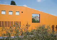 Modern architecture with background slums. Televisa Santa Fe, Legorreta, Santa Fe Mexico