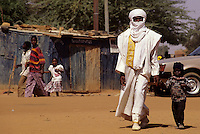 Niamey, Niger - Tuareg Man and Son.  His Veil, the Tagulmust, Covers his Mouth, as is the Tuareg Custom.