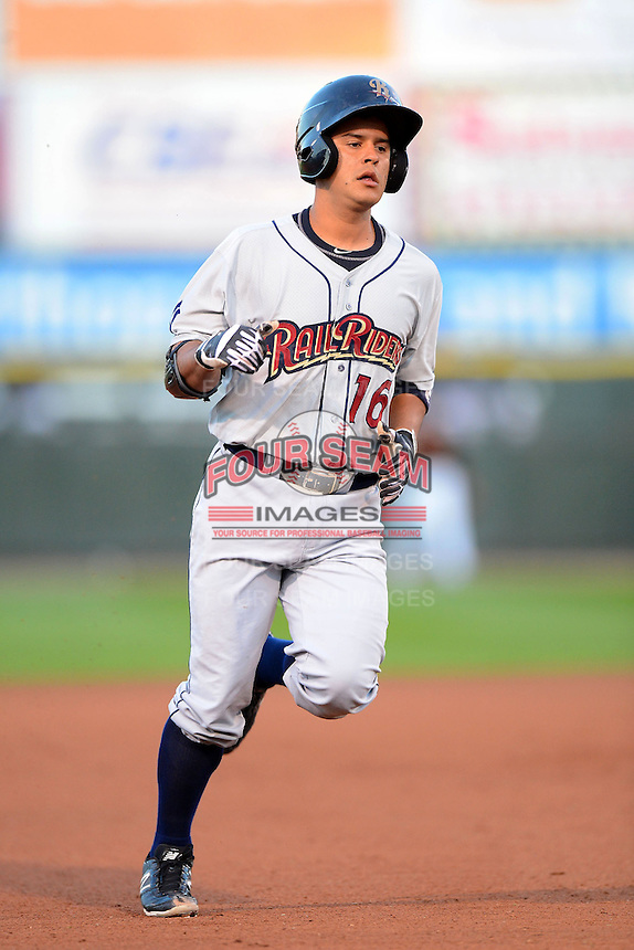 Scranton Wilkes-Barre RailRiders second baseman Walter Ibarra #16 runs the bases after hitting a home run during a game against the Rochester Red Wings on June 19, 2013 at Frontier Field in Rochester, New York.  Scranton defeated Rochester 10-7.  (Mike Janes/Four Seam Images)