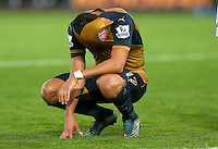 Alexis Sanchez of Arsenal pulls his shirt over his head in frustration during the Barclays Premier League match between Swansea City and Arsenal played at The Liberty Stadium, Swansea on October 31st 2015