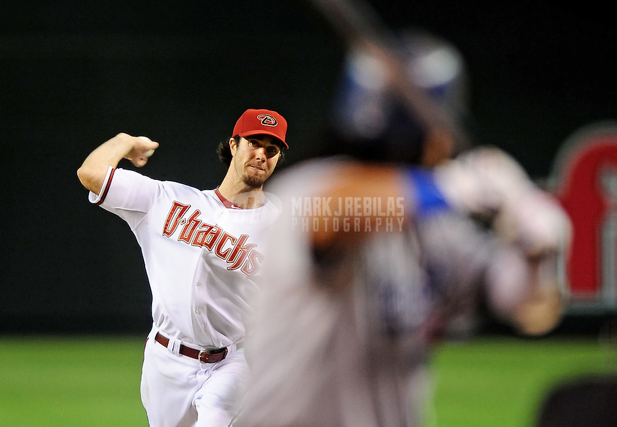 May 11, 2010; Phoenix, AZ, USA; Arizona Diamondbacks pitcher Dan Haren throws in the fourth inning against the Los Angeles Dodgers at Chase Field. Mandatory Credit: Mark J. Rebilas-