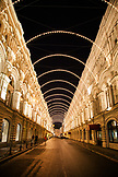 RUSSIA, Moscow. A street decorated with lights at night outside of GUM Department Store by the Red Square.