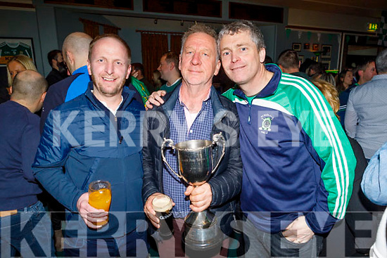 Ger Carmody, Brendan McCarthy and Pa Daly celebrate Na Gaels victory in the All Ireland Junior championship in the clubhouse on Saturday night.
