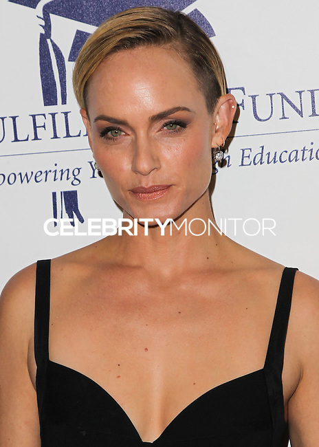 BEVERLY HILLS, CA, USA - OCTOBER 14: Amber Valletta arrives at the 20th Annual Fulfillment Fund Stars Benefit Gala held at The Beverly Hilton Hotel on October 14, 2014 in Beverly Hills, California, United States. (Photo by Celebrity Monitor)