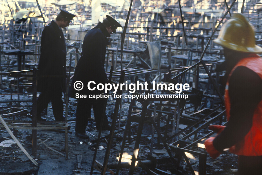 Stardust Fire Tragedy, Stardust Nightclub, Artane, Dublin, Ireland, early hours, 14th February 1981, Valentine's Day, in which 48 died and 214 were injured -  police and firemen sift through the debris.  198102140003..Copyright Image from Victor Patterson, 54 Dorchester Park, Belfast, United Kingdom, UK...For my Terms and Conditions of Use go to http://www.victorpatterson.com/Victor_Patterson/Terms_%26_Conditions.html