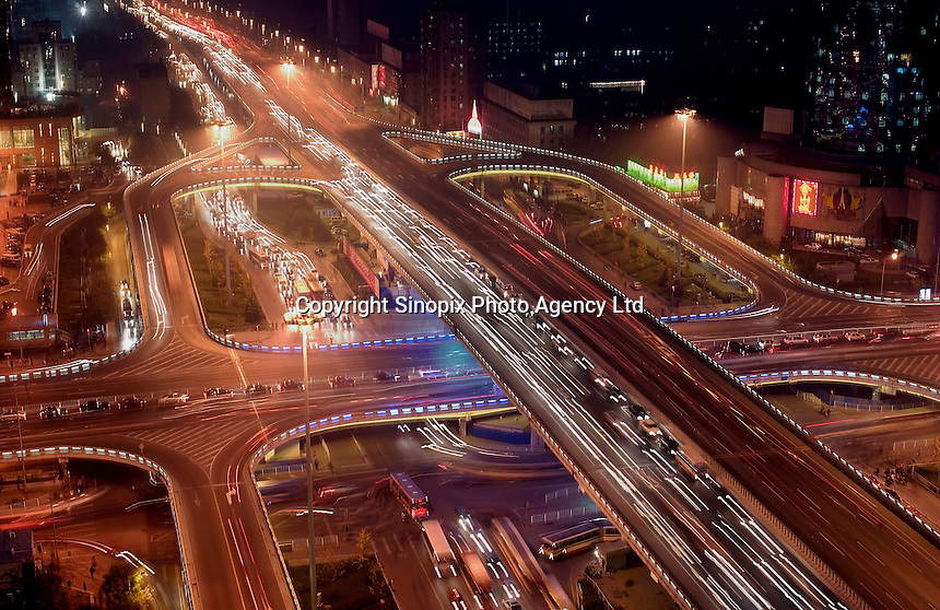 Heavy rush-hour traffic on Beijing's inner ring-road pass through the business district, China..