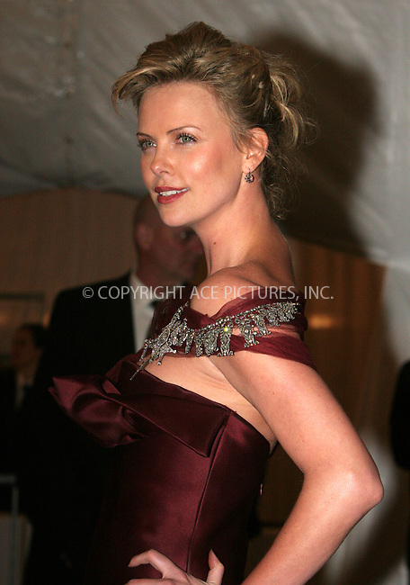 "WWW.ACEPIXS.COM . . . . .  ....NEW YORK, MAY 1, 2006....Charlize Theron at the ""AngloMania"" Costume Institute Gala at The Metropolitan Museum of Art - Exits....Please byline: NANCY RIVERA- ACEPIXS.COM.... *** ***..Ace Pictures, Inc:  ..Craig Ashby (212) 243-8787..e-mail: picturedesk@acepixs.com..web: http://www.acepixs.com"