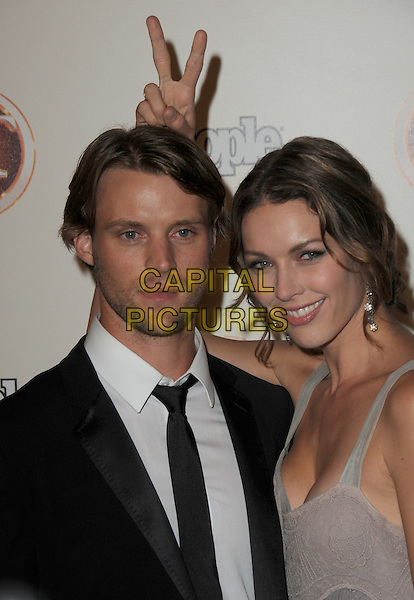JESSE SPENCER & LOUISE GRIFFITHS.13th Entertainment Tonight Emmy Party Sponsored by People Magazine held at Vibiana, Los Angeles, California, USA..September 20th, 2009.emmys half length black suit jacket dress purple lilac stubble facial hair hand v finger bunny ears funny .CAP/ADM/GS.©George Shepherd/AdMedia/Capital Pictures.