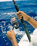 USA, Florida, man reeling fishing rod, close-up, Islamorada