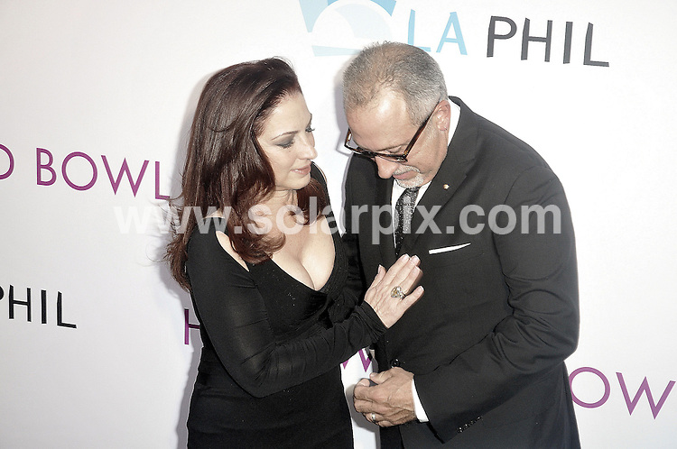 **ALL ROUND PICTURES FROM SOLARPIX.COM**                                             **SYNDICATION RIGHTS FOR UK, AUSTRALIA, DENMARK, PORTUGAL, S. AFRICA, SPAIN & DUBAI (U.A.E) & ASIA (EXCLUDING JAPAN) ONLY**                                                                                  Caption: Hollywood Bowl Hall of Fame Ceremony - Arrivals - Hollywood Bowl - Hollywood, CA, USA                                                                                    This pic: Gloria Estefan and Emilio Estefan                                                                                            JOB REF: 13602      PHZ Uema       DATE: 17_06_2011                                                            **MUST CREDIT SOLARPIX.COM OR DOUBLE FEE WILL BE CHARGED**                                                                        **MUST NOTIFY SOLARPIX OF ONLINE USAGE**                 **CALL US ON: +34 952 811 768 or LOW RATE FROM UK 0844 617 7637**