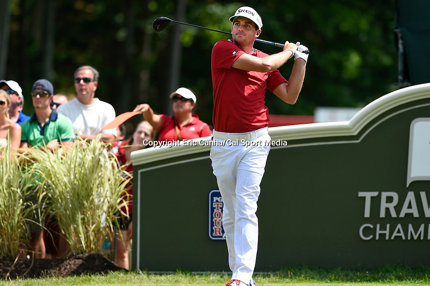 June 22, 2014 - Cromwell, Connecticut - Keegan Bradley tees off on the 18th hole during the final round of the PGA Travelers Championship tournament held at TPC River Highlands in Cromwell, Connecticut.  Eric Canha/CSM