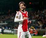 Nederland, Almelo, 20 oktober 2012.Eredivisie .Seizoen 2012-2013.Heracles-Ajax.Lasse Schone van Ajax juicht nadat Ben Rienstra van Heracles een eigen doelpunt heeft gemaakt, de 0-1.