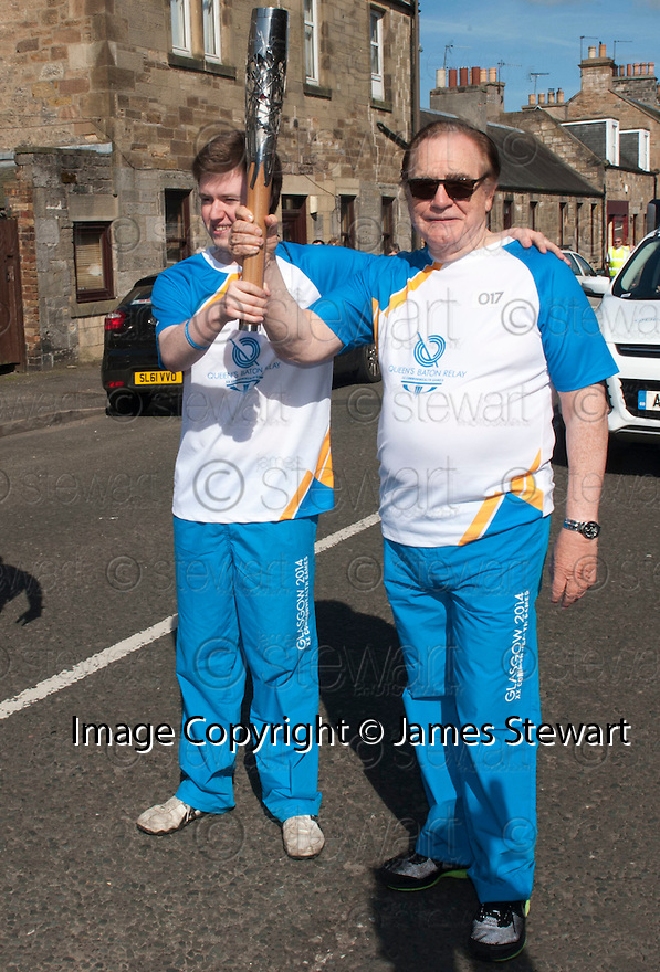 Hollywood actor and current Rector of The University of Dundee, Brian Cox, receives the Queen's Baton from 17 year old Ally Brown from Balerno, before heading off to Rosslyn Chapel.