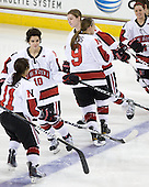 Rachel Llanes (NU - 11), Autumn Prouty (NU - 10), Casie Fields (NU - 9), Alyssa Wohlfeiler (NU - 8), Maggie DiMasi (NU - 4) - The Harvard University Crimson defeated the Northeastern University Huskies 4-3 (SO) in the opening round of the Beanpot on Tuesday, February 8, 2011, at Conte Forum in Chestnut Hill, Massachusetts.