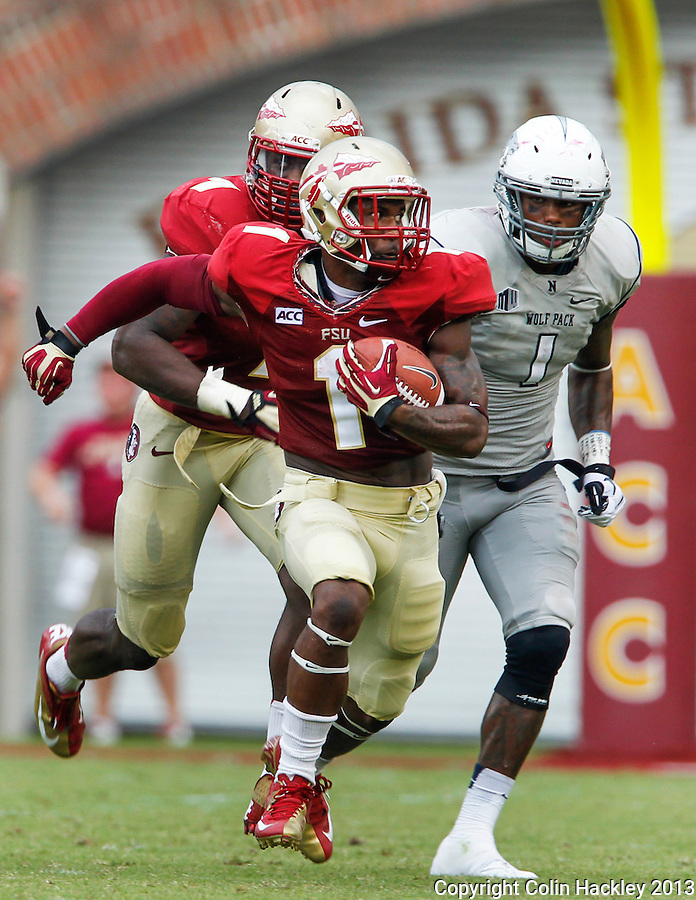 TALLAHASSEE, FLA 9/14/13-FSU-NEV091413CH-Florida State's Tyler Hunter runs after intercepting a Nevada pass as the Wolf Pack's Brandon Wimberly chases during second half action Saturday at Doak Campbell Stadium in Tallahassee. The Seminoles beat the Wolf Pack 62-7.<br /> COLIN HACKLEY PHOTO