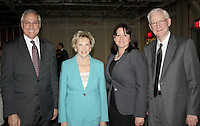 NWA Democrat-Gazette/CARIN SCHOPPMEYER Dr. Dan Rahn, University of Arkansas for Medical Sciences chancellor (from left), Johnelle Hunt, Pearl McElfish, UAMS Northwest associate vice chancellor, and Dr. Peter Kohler, UAMS Northwest vice chancellor, welcome Friends of UAMS to a reception Wednesday at the Hunt Tower in Rogers. Kohler will retire