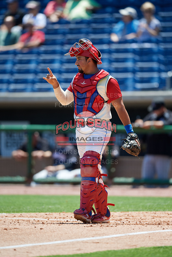 Clearwater Threshers catcher Edgar Cabral (30) signals to the defense during a game against the Jupiter Hammerheads on April 11, 2018 at Spectrum Field in Clearwater, Florida.  Jupiter defeated Clearwater 6-4.  (Mike Janes/Four Seam Images)
