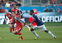 14 April 2012: Toronto FC midfielder Eric Avila #8 and Chivas USA midfielder Oswaldo Minda #8 in action during the second half in a game between Chivas USA and Toronto FC at BMO Field in Toronto..Chivas USA won 1-0.