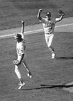 Dennis Eckersley and Carney Lansford celebrate the final out as the Oakland Athletics sweep the Boston  Red Sox to win the 1988 American League playoffs..(1988 photo by Ron Riesterer)