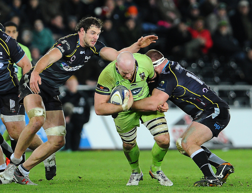 Northampton Saints Sam Dickinson is tackled by Ospreys Dimitri Arhip<br /> <br /> Photographer Craig Thomas/CameraSport<br /> <br /> Rugby Union - European Rugby Champions Cup - Pool 5 - Ospreys v Northampton Saints - Sunday 18th January 2015 - Liberty Stadium - Swansea<br /> <br /> &copy; CameraSport - 43 Linden Ave. Countesthorpe. Leicester. England. LE8 5PG - Tel: +44 (0) 116 277 4147 - admin@camerasport.com - www.camerasport.com
