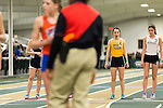 January 25, 2014. Winston Salem, North Carolina.<br /> Kayla Montgomery, #4, yawns as she prepares to start her run in the 1600m at the 2014 David Oliver Classic. She hoped to get a personal best time in the event, which is not her strongest as she tends to place higher in endurance events. Due to her MS, she tires easily and frequently cannot feel her legs while running.<br />  3 and a half years ago, during an examination after sustaining tailbone and head injuries from a fall during a soccer game, Kayla Montgomery, now 18, was diagnosed with multiple sclerosis. Montgomery, then a decent runner, refused to be limited by her diagnosis, and after years of training has become one of the best high school runners in the country.