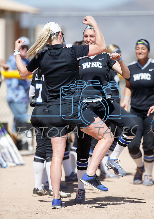 Western Nevada's Assistant Coach Bethany Henry-Herman and Chelsea Latu with their pregame rituals before the game against Colorado North Western at Edmonds Sports Complex Carson City, Nev., on Friday, March 18, 2016.<br /> Photo by Jeff Mulvihill, Jr.