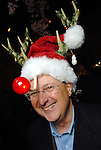 Jim Clepper shows his spirit at the Carmen and David Bridges Joyful Toyful Fiesta 19th Annual Holiday Toy Drive Party at Gigi's Asian Bistro & Dumpling Bar in the Galleria Tuesday Dec. 01,2009. (Dave Rossman/For the Chronicle)