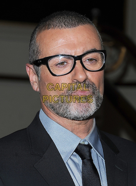 GEORGE MICHAEL.announces his eagerly awaited return to the stage with Symphonica: The Orchestral Tour, his first European dates since his 25Live tour concluded in Copenhagen back in August 2008..Royal Opera House, London, England, UK, 11th May 2011..portrait headshot glasses black grey gray tie blue shirt beard facial hair Press conference.CAP/BEL.©Tom Belcher/Capital Pictures.