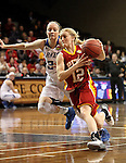 SIOUX FALLS MARCH 22:  Hadyn Herlocker #12 from Pittsburg State gets a step past Bailey Cairnduff #34 from Grand Valley State during their quarterfinal game at the NCAA Women's Division II Elite 8 Tournament at the Sanford Pentagon in Sioux Falls, S.D. (Photo by Dave Eggen/Inertia)