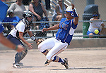 Western Nevada's Briauna Carter scores the winning run against College of Southern Nevada catcher Rebekka Gross at Edmonds Sports Complex Carson City, Nev., on Saturday, May 2, 2015. <br /> Photo by Cathleen Allison/Nevada Photo Source