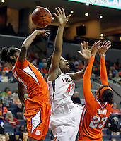 Virginia forward Sarah Imovbioh (42) gets fouled under the basket by Clemson guard/forward Nikki Dixon (21) next to Clemson guard Chancie Dunn (23) during the game Sunday in Charlottesville, VA. Photo/The Daily Progress/Andrew Shurtleff